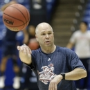 St. Mary's head coach Randy Bennett passes a ball during practice on Monday, March 18, 2013, ahead of their first-round NCAA college basketball tournament game in Dayton, Ohio. Saint Mary's is scheduled to face Middle Tennessee Tuesday evening. (AP Photo/Al Behrman)