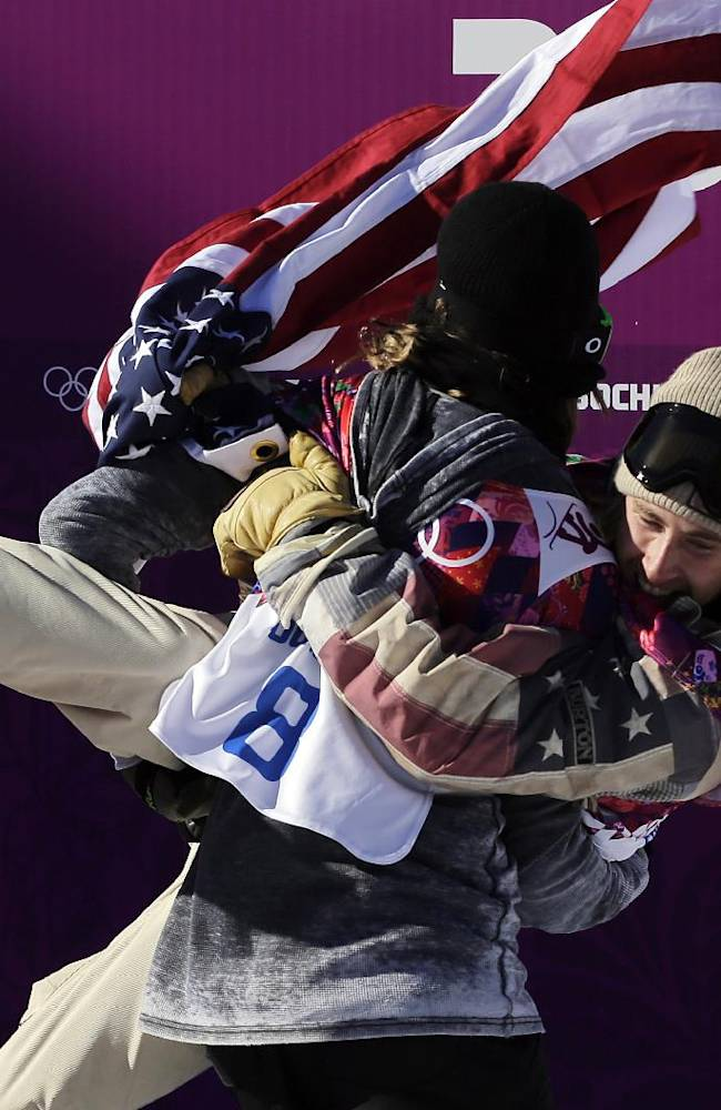 United States' Sage Kotsenburg, right, is carried by Norway's Staale Sandbech after Kotsenburg won the men's  snowboard slopestyle final at the Rosa Khutor Extreme Park, at the 2014 Winter Olympics, Saturday, Feb. 8, 2014, in Krasnaya Polyana, Russia