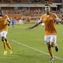 Houston Dynamo forward Will Bruin (12) celebrates his second goal of the game, with midfielder Boniek Garcia (27), against the Montreal Impact during a knockout-round match in the MLS Cup soccer playoffs, Thursday, Oct. 31, 2013, in Houston. Houston won 3