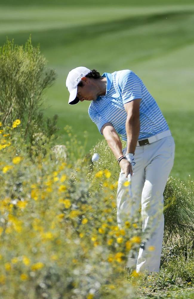 Rory McIlroy, of Northern Ireland, hits from the desert on the 13th hole in his match against Harris English  during the second round of the Match Play Championship golf tournament on Thursday, Feb. 20, 2014, in Marana, Ariz