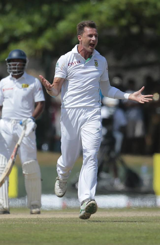 South African bowler Dale Steyn, right, celebrates taking the wicket of Sri Lankan batsman Kaushal Silva as non striker Kumar Sangakkara watches during the fifth day of the first test cricket match in Galle, Sri Lanka, Sunday, July 20, 2014