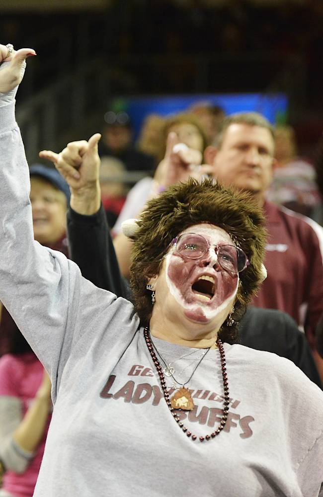 West Texas A&M student Vonnita Elliott, 57, of Amarillo, Texas, cheers for the school's women's basketball team during the final minutes in an NCAA women's Division II college basketball tournament semifinal against Nova Southeastern in Erie, Pa., on Wednesday, March 26, 2014. Texas A&M won 80-66