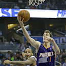 Phoenix Suns' Goran Dragic (1), of Slovenia, makes a shot in front of Orlando Magic's Jameer Nelson during the first half of an NBA basketball game in Orlando, Fla., Sunday, Nov. 24, 2013 The Associated Press