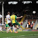 Fulham's Hugo Rodallega, left no. 20, scores against Norwich City during their English Premier League soccer match at Craven Cottage, London, Saturday April 12, 2014