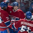 Montreal Canadiens' Brendan Gallagher, center, celebrates his goal past Dallas Stars goalie Kari Lehtonen with teammates P.K. Subban, left, and David Desharnais during the second period of an NHL hockey game Tuesday, Jan. 27, 2015, in Montreal The Associa