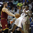 Cleveland Cavaliers' Spencer Hawes, left, defends against Atlanta Hawks' Louis Williams as Cavaliers head coach Mike Brown, rear, watches in the third quarter of an NBA basketball game, Friday, April 4, 2014, in Atlanta The Associated Press