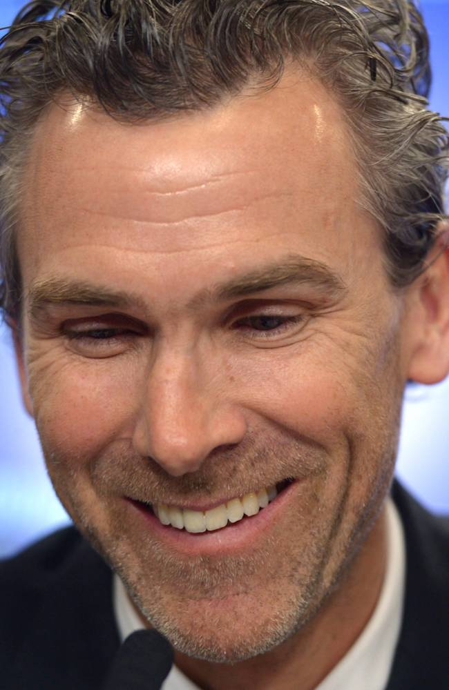 Former Vancouver Canucks captain Trevor Linden laughs during a press conference in Vancouver on Wednesday, April 9, 2014. Linden has been hired as Vancouver's president of hockey operations