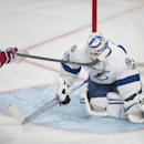 Montreal Canadiens' Daniel Briere, left, scores against Tampa Bay Lightning's goalie Anders Lindback during first period NHL Stanley Cup playoff action in Montreal, Tuesday, April 22, 2014 The Associated Press