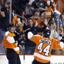 Philadelphia Flyers' Vincent Lecavalier, left, and Kimmo Timonen, of Finland, celebrate after Lecavalier's goal during the first period of an NHL hockey game against the Boston Bruins, Sunday, March 30, 2014, in Philadelphia The Associated Press