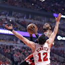 Washington Wizards guard John Wall, left, shoots over Chicago Bulls guard Kirk Hinrich (12) during the first half of Game 2 in an opening-round NBA basketball playoff series game Tuesday, April 22, 2014, in Chicago The Associated Press