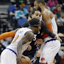 New York Knicks' Tyson Chandler, right, sets a pick on Minnesota Timberwolves' Kevin Martin as Knicks' J.R. Smith, left, drives around him in the first quarter of an NBA basketball game, Wednesday, March 5, 2014, in Minneapolis The Associated Press