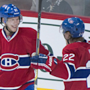 Montreal Canadiens' Lars Eller, left, celebrates with teammate Dale Weise after scoring against the New York Rangers during the second period of an NHL hockey game Saturday, Oct. 25, 2014, in Montreal The Associated Press