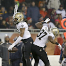 New Orleans Saints free safety Pierre Warren (42) celebrates with defensive back Terrence Frederick (37) after intercepting a pass intended for Chicago Bears wide receiver Alshon Jeffery (17) during the second half of an NFL football game Monday, Dec. 15,