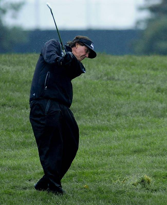 Phil Mickelson hits from the rough on the first hole during the final round of the BMW Championship golf tournament at Conway Farms Golf Club in Lake Forest, Ill., Sunday Sept. 15, 2013