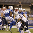 Indianapolis Colts strong safety Mike Adams, left, intercepts a pass intended for New England Patriots tight end Rob Gronkowski during the first half of an NFL football game in Indianapolis, Sunday, Nov. 16, 2014 The Associated Press