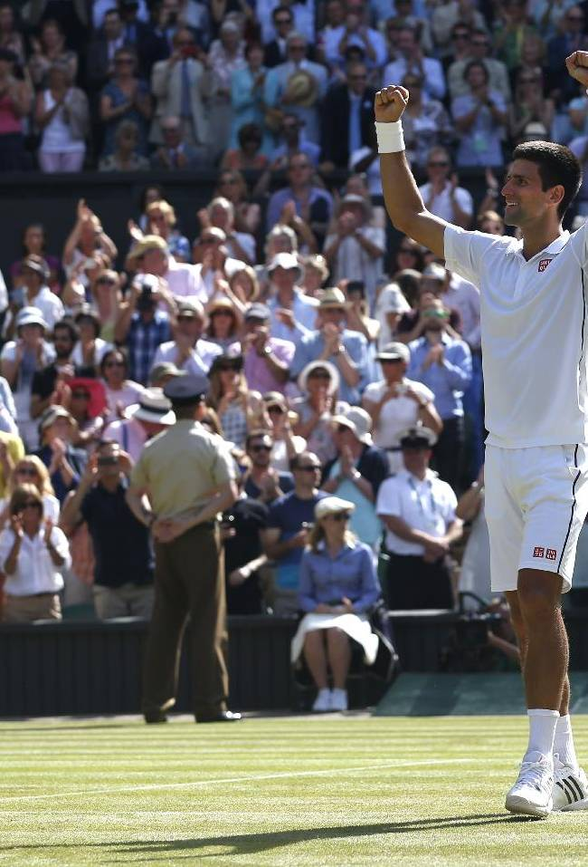 Novak Djokovic of Serbia celebrates after defeating Grigor Dimitrov of Bulgaria in their men's singles semifinal match plays a return to during their match at the All England Lawn Tennis Championships in Wimbledon, London, Friday, July 4, 2014