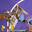Los Angeles Lakers guard Jodie Meeks, left, puts up a shot as Memphis Grizzlies forward Tayshaun Prince defends during the first half of an NBA basketball game, Sunday, April 13, 2014, in Los Angeles The Associated Press