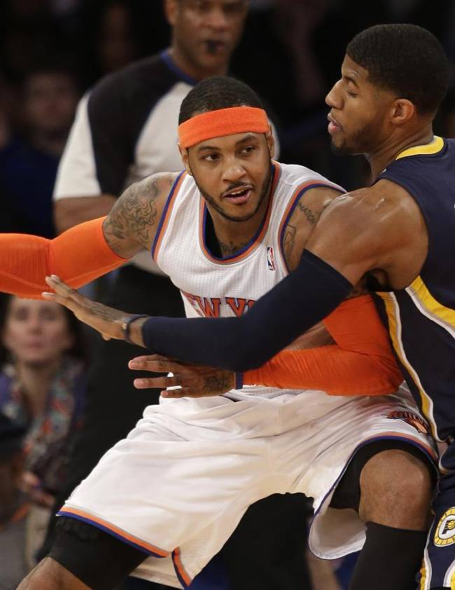 New York Knicks' Carmelo Anthony, left, tries to move around Indiana Pacers' Paul George during the first half of an NBA basketball game at Madison Square Garden on Wednesday, March 19, 2014, in New York