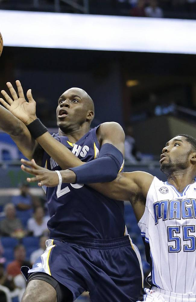 Memphis Grizzlies' Quincy Pondexter, left, gets to the basket in front of Orlando Magic's E'Twaun Moore (55) during the first half of an NBA preseason basketball game in Orlando, Fla., Friday, Oct. 18, 2013