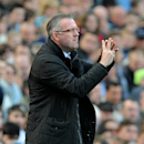 Aston Villa manager Paul Lambert gives instructions from the touch line during the English Premier League soccer match between Aston Villa and Southampton at Villa Park, in Birmingham, England, Saturday, April 19, 2014