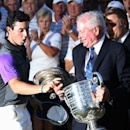 Aug 10, 2014; Louisville, KY, USA; PGA golfer Rory McIlroy catches the Wanamaker Trophy as it slips out of the hands of PGA president Ted Bishop when presented after winning the 2014 PGA Championship golf tournament at Valhalla Golf Club. Mandatory Credit: Brian Spurlock-USA TODAY Sports