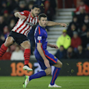 Southampton's Graziano Pelle, left watches his shot just miss the goal with Manchester United's Michael Carrick during their English Premier League soccer match between Southampton and Manchester United at St Mary's stadium in Southampton, England, Monday