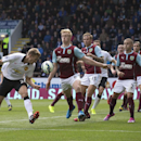 Manchester United's Darren Fletcher, left, has a header blocked by Burnley's Ben Mee, centre left, during their English Premier League soccer match at Turf Moor Stadium, Burnley, England, Saturday Aug. 30, 2014
