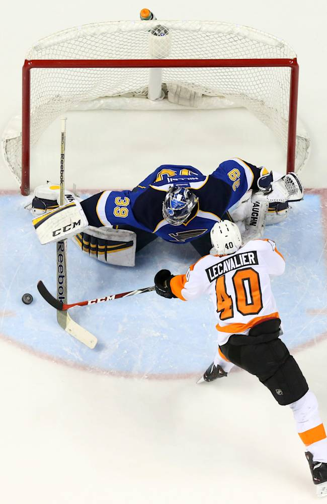 St. Louis Blues goaltender Ryan Miller stops a shot by Philadelphia Flyers center Vincent Lecavalier in a shootout during a game between the St. Louis Blues and the Philadelphia Flyers on Tuesday, April 1, 2014, at the Scottrade Center in St. Louis