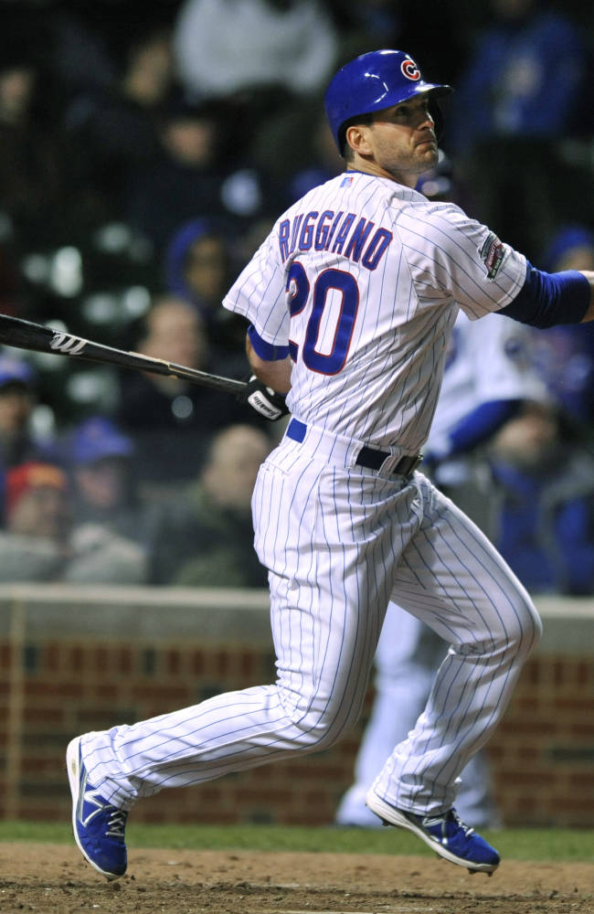 In this April 22, 2014, file photo Chicago Cubs' Justin Ruggiano watches his 2 RBI single during the eighth inning of a baseball game against the Arizona Diamondbacks in Chicago. The Mariners have found a right-handed bat for their outfield, acquiring Ruggiano from the Cubs. Seattle sent minor league pitcher Matt Brazis to Chicago as part of Wednesday's, Dec. 17, 2014, trade