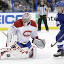 Montreal Canadiens goalie Carey Price (31) makes a save on a shot by Tampa Bay Lightning right wing Ryan Callahan (24) during the second period of Game 1 of a first-round NHL hockey playoff series on Wednesday, April 16, 2014, in Tampa, Fla The Associated
