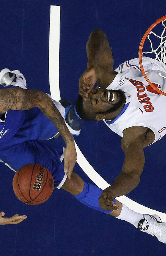 No. 1 Florida holds off Kentucky 61-60 in SEC