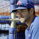 Toronto Blue Jays catcher Josh Thole stands behind the batting cage before a spring training baseball game against the New York Yankees in Dunedin, Fla., Wednesday, March 26, 2014. The Blue Jays announced Wednesday that Thole will be the Jays back-up catc