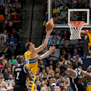 Timofey Mozgov #25 of the Denver Nuggets scores over Kevin Garnett #2 of the Brooklyn Nets during the second quarter at Pepsi Center on February 27, 2014 in Denver, Colorado. (Photo by Justin Edmonds/Getty Images)