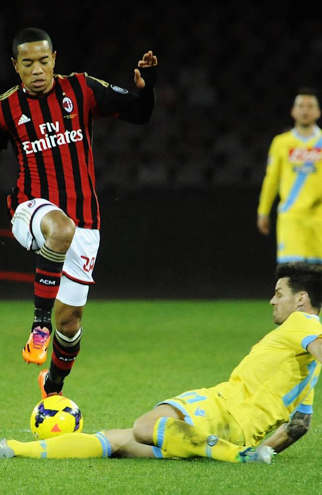 AC Milan's Robinho is tackled by Napoli's Christian Maggio during a Serie A soccer match between Napoli and Milan, at the San Paolo stadium in Naples, Italy, Saturday, Feb. 8, 2014