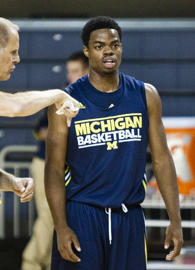 Michigan head coach John Beilein, left, gives direction to freshman guard Derrick Walton Jr. during a practice session after NCAA college basketball media day on Thursday, Oct. 24, 2013, in Ann Arbor, Mich