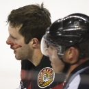 Calgary Flames' Lee Stempniak leaves the ice with a bloody nose following a fight with Edmonton Oilers' Andrew Ference during the first period of an NHL hockey game Saturday, Nov. 16, 2013 in Calgary, Alberta The Associated Press