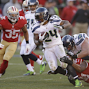 Seattle Seahawks running back Marshawn Lynch carries the ball as San Francisco 49ers defensive end Ray McDonald (91) tries to make the stop in the second half of an NFL football game, Sunday, Dec. 8, 2013, in San Francisco. At left is San Francisco 49ers