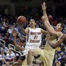 Boston College's Olivier Hanlan, left, drives against Georgia Tech's Daniel Miller, right, during the first half of an NCAA college basketball game at the Atlantic Coast Conference tournament in Greensboro, N.C., Thursday, March 14, 2013. (AP Photo/Gerry Broome)