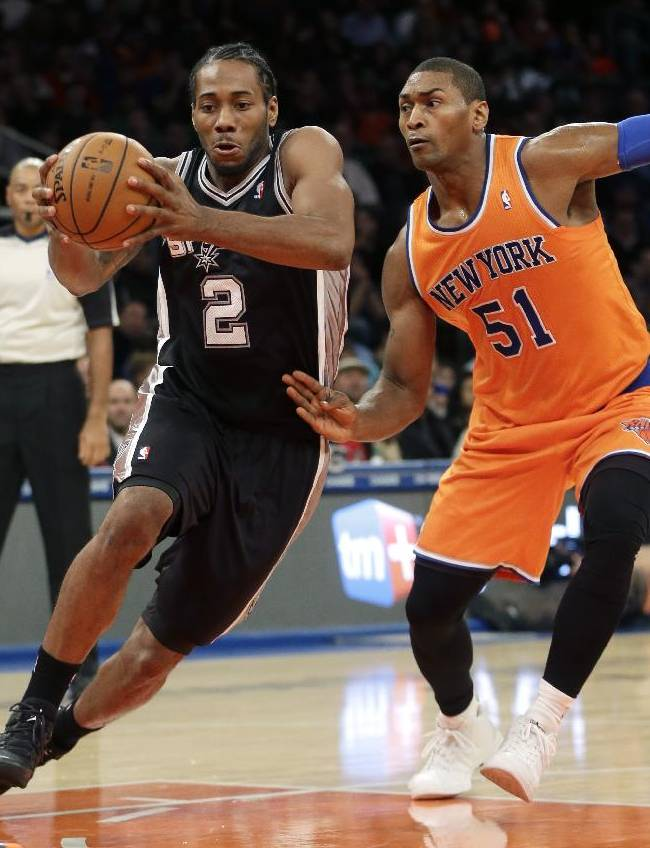 San Antonio Spurs' Kawhi Leonard, left, moves past New York Knicks' Metta World Peace during the first half of an NBA basketball game at Madison Square Garden, Sunday, Nov. 10, 2013 in New York