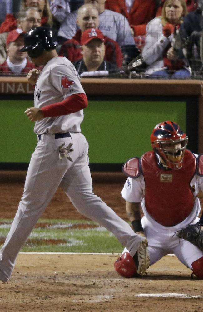 Boston Red Sox's Xander Bogaerts punches the air as he scores on an RBI ground rule double by David Ross during the seventh inning of Game 5 of baseball's World Series against the St. Louis Cardinals  Monday, Oct. 28, 2013, in St. Louis