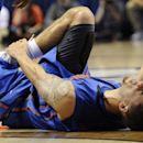 Florida's Scottie Wilbekin lays on the floor injured during the second half of an NCAA college basketball game against Connecticut, Monday, Dec. 2, 2013, in Storrs, Conn. Connecticut won 65-64. (AP Photo/Jessica Hill)