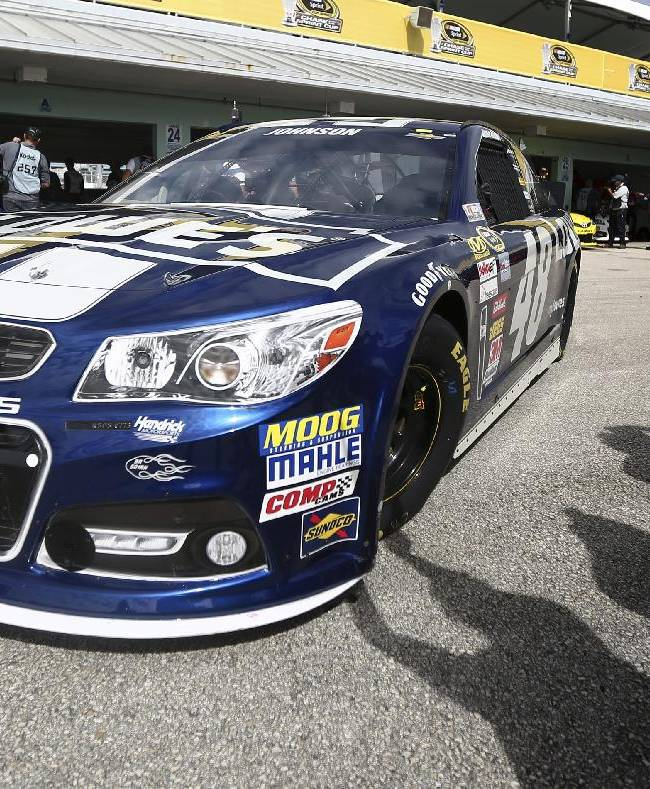 Jimmie Johnson leaves the garage during practice for Sunday's NASCAR Sprint Cup series auto race at the Homestead-Miami Speedway, Saturday, Nov. 16, 2013, in Homestead, Fla