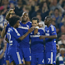 Chelsea celebrates the opening goal by Cesc Fabregas, 2nd from right, during the Champions League Group G soccer match between Chelsea and Schalke 04 at Stamford Bridge stadium in London Wednesday, Sept. 17, 2014