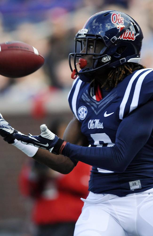 Mississippi wide receiver Terrell Grant (8) makes a touchdown catch against Troy during an NCAA college football game in Oxford, Miss., Saturday, Nov. 16, 2013