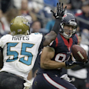 Houston Texans tight end Ryan Griffin (84) makes a reception in front of Jacksonville Jaguars outside linebacker Geno Hayes (55) during the third quarter of an NFL football game Sunday, Nov. 24, 2013, in Houston The Associated Press