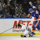 New York Islanders' Matt Carkner (7) loses his stick as Pittsburgh Penguins' Chris Conner (23) dives for the puck in the first period of an NHL hockey game on Tuesday, Dec. 3, 2013, in Uniondale, N.Y The Associated Press