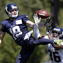 Seattle Seahawks wide receiver Bryan Walters (19) and cornerback Akeem Auguste reach for a pass at an NFL football camp practice on Saturday, July 26, 2014, in Renton, Wash The Associated Press