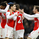 Arsenal's Hector Bellerin, second left, celebrates with teammates after he scored their fifth goal during the English Premier League soccer match between Arsenal and Aston Villa at the Emirates stadium in London, Sunday, Feb. 1, 2015