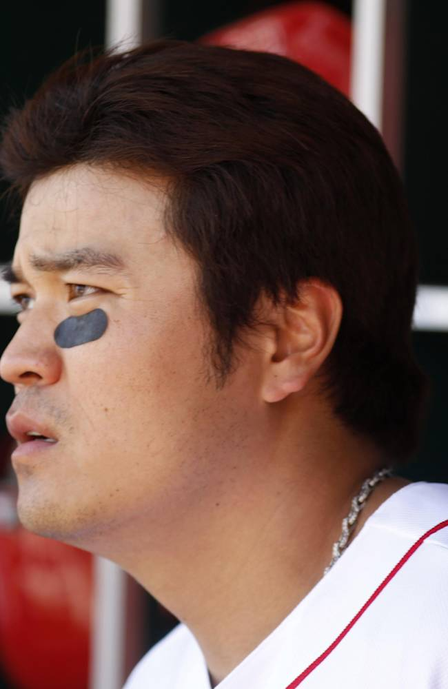 Cincinnati Reds center fielder Shin-Soo Choo watches from the dugout during a baseball game against the Cleveland Indians, Monday, May 27, 2013, in Cincinnati