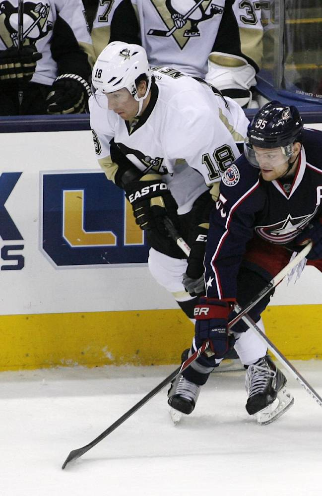 Columbus Blue Jackets' Mark Letestu (55) and  Pittsburgh Penguins' James Neal (18) tangle during the third period of an NHL hockey game, Friday, March 28, 2014, in Columbus, Ohio